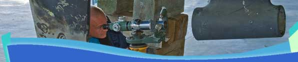 Propulsion system alignment in progress using specialized optical aligning equipment