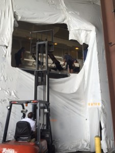 Using a forklift to reinstall ladder